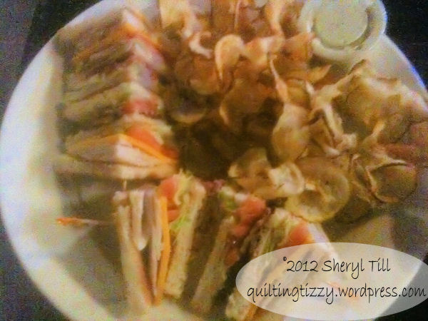 Club sandwich served with ribbon fries