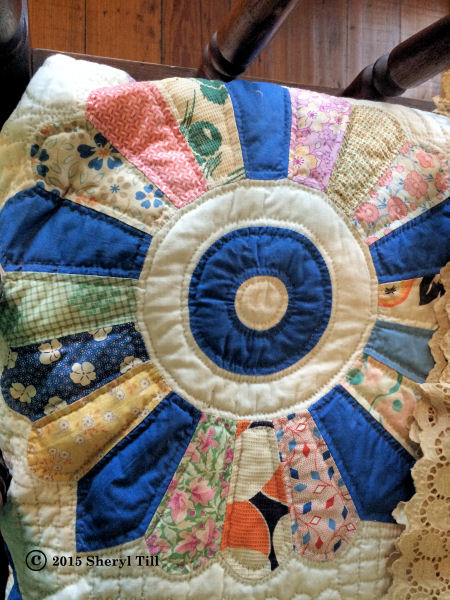 A nice example of a Dresden Plate quilt.  I don't think this is from the home as it appears these are feedsack patches which would have come later.