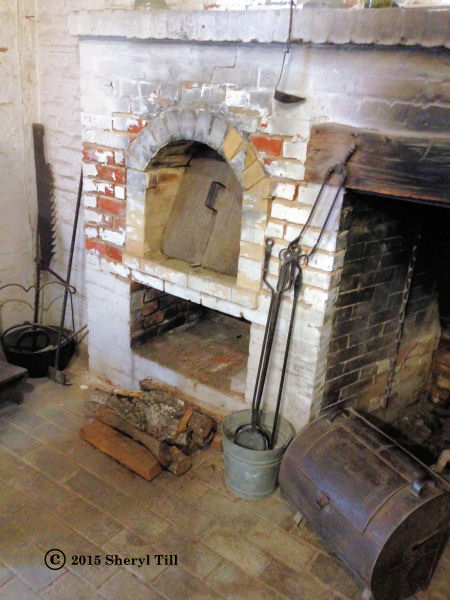 Open hearth and oven in the detached kitchen.